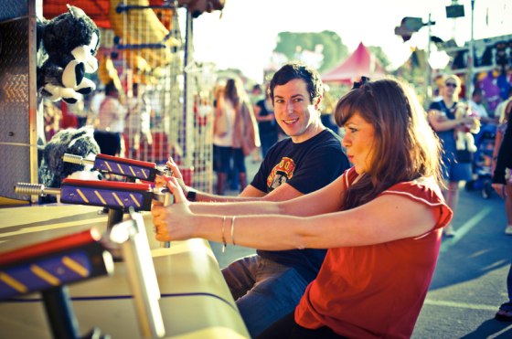 couple-playing-amusement-game-shooting
