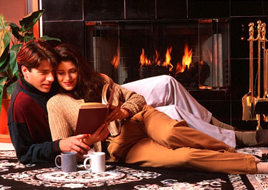 couple reading by fireplace