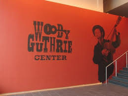 woody guthrie center orange close up sign inside