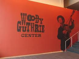 woody guthrie center orange close up sign inside