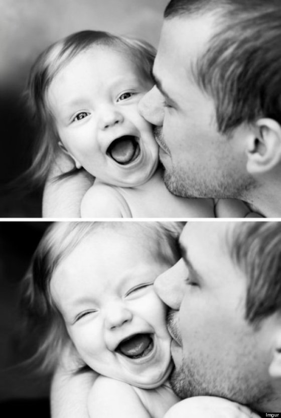 dad kissing young child
