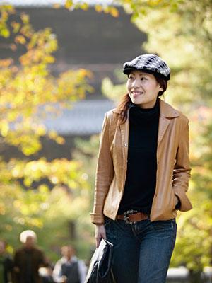 woman outside looking happy