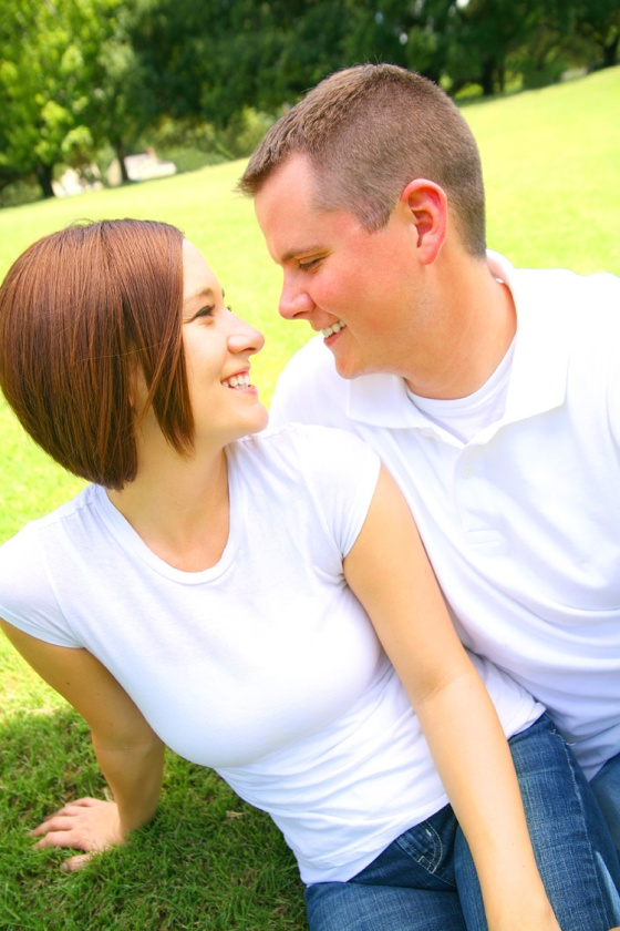 happy couple looking at each other on a lawn clip art