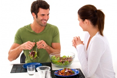 couple eating salad and smiling