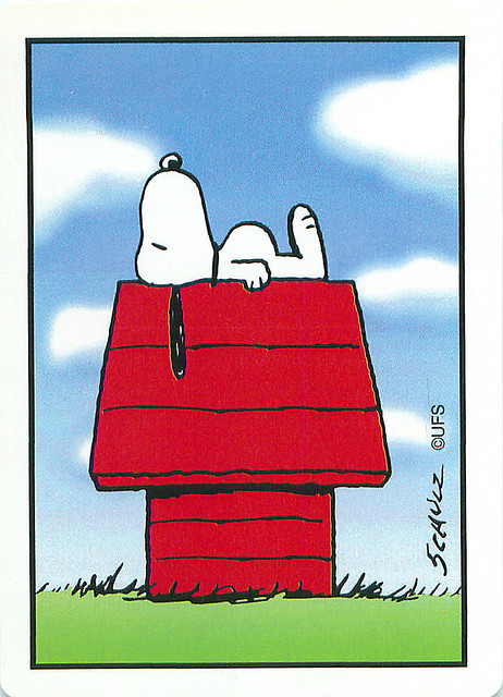 snoopy on top his house, laying flat depressed look