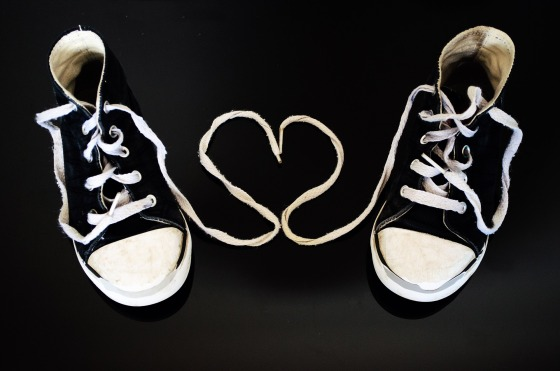 tennis shoes black and white with heart in between