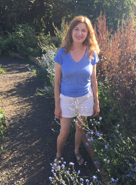 Tanna at Fairbanks Botaninal Garden August 2017 off the path by some blue flowers