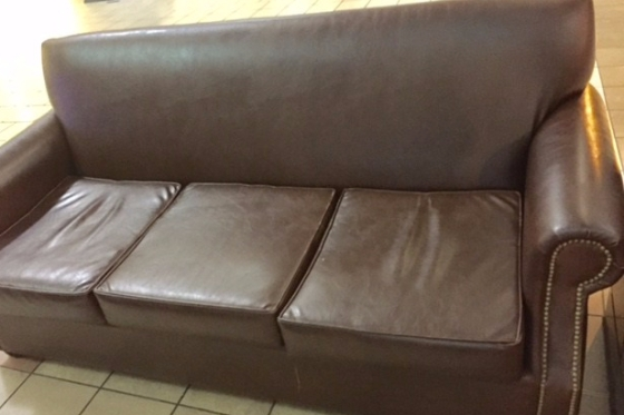The Brown Couch at the Airport